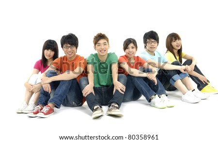 Friends sitting on the floor - stock photo