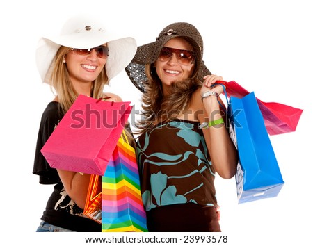 friends smiling with shopping bags - isolated over a white background - stock photo