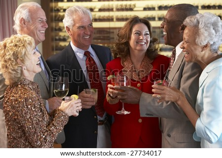 Friends Socializing At A Bar - stock photo