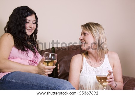 Friends Socializing at Home and Drinking Wine