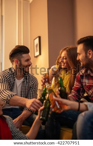 Friends spending time together and drinking beer. - stock photo