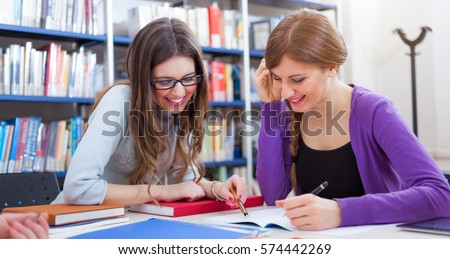 Friends studying together in a library