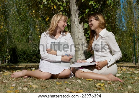 friends studying together in park - stock photo
