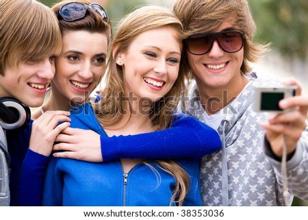 Friends taking photo - stock photo