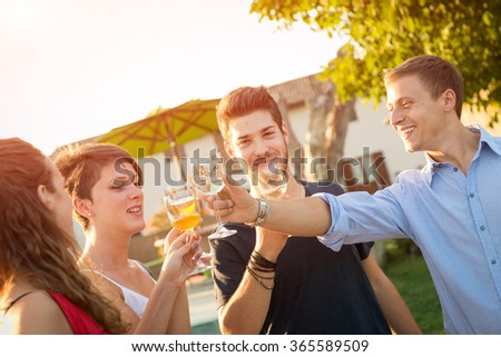 Friends toasting at party for the happy hour - stock photo