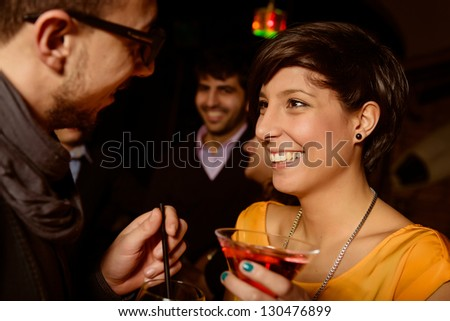 friends toasting at the disco,Italy - stock photo