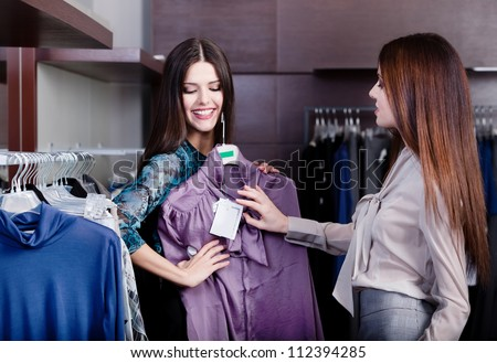 Friends try on an amazing dress - stock photo