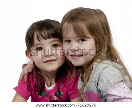 Friends - Two Adorable little girls isolated on white background - stock photo
