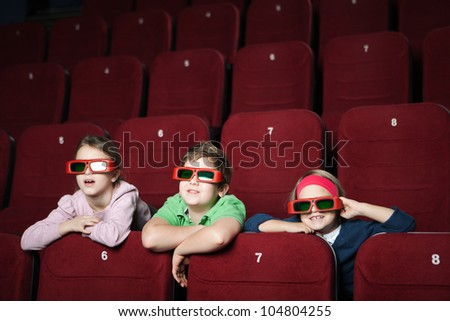 Friends watching a cartoon in the movie theater