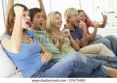 Friends Watching A Game On Television - stock photo