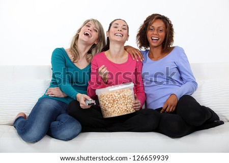 Friends watching a movie together - stock photo