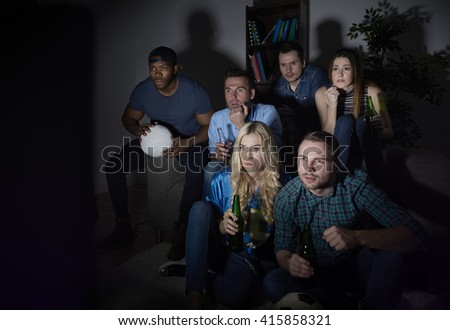 Friends watching match in silence - stock photo