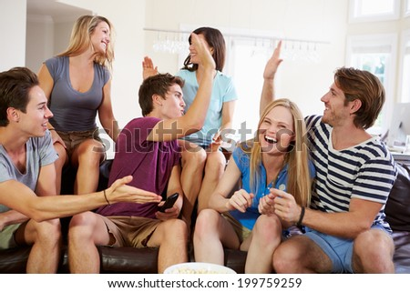 Friends Watching Sport Celebrating Goal - stock photo