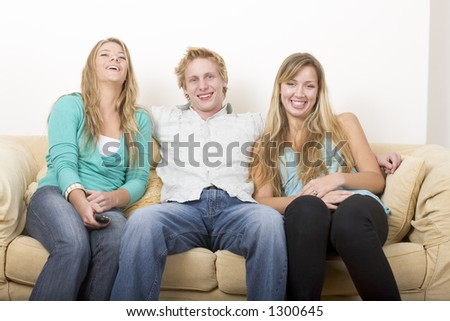 Friends watching TV 3 - stock photo