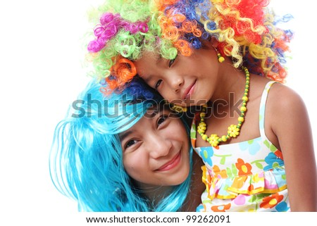 friends wearing colorful funny hairpiece. - stock photo