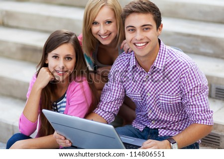 Friends with laptop - stock photo