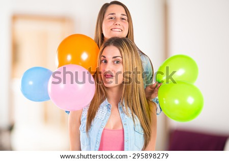 Friends with many balloons