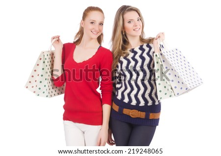 Friends with shopping bags isolated on white - stock photo