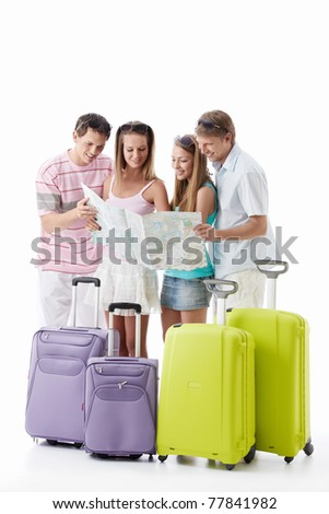 Friends with suitcases look the map on a white background - stock photo