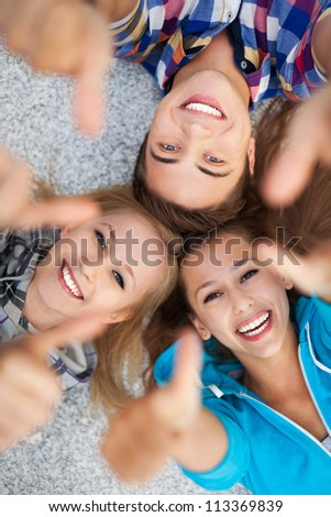 Friends with thumbs up - stock photo