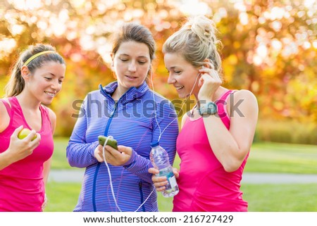 friendship and fitness in the parc - stock photo