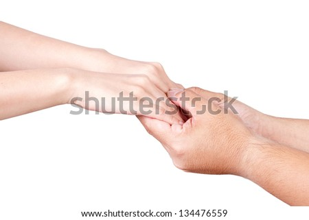 Friendship and love concept between man and woman - man's hand hold by a girl hand isolated on the white background - stock photo