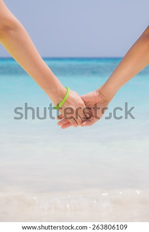 Friendship and love concept between man and woman on crystal clear water at Similan island, Thailand - stock photo