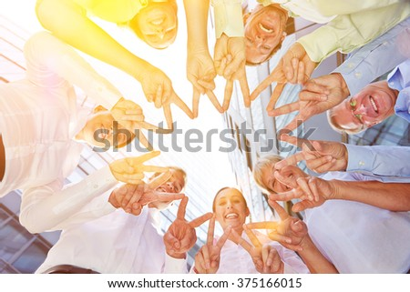 Friendship and solidarity with hands of business people forming a star shape