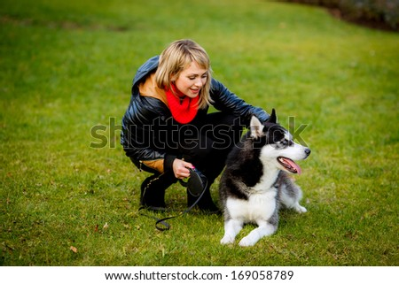 Friendship between human and dog. blue-eyed husky. walk in nature