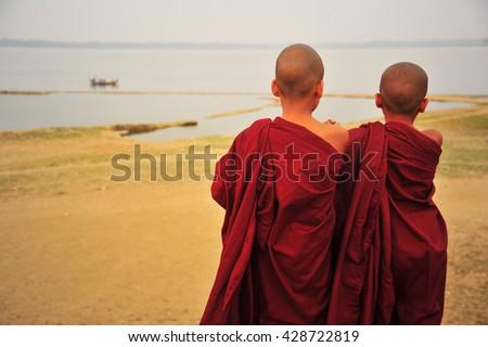 Friendship Between Little Monks in Myanmar  - stock photo