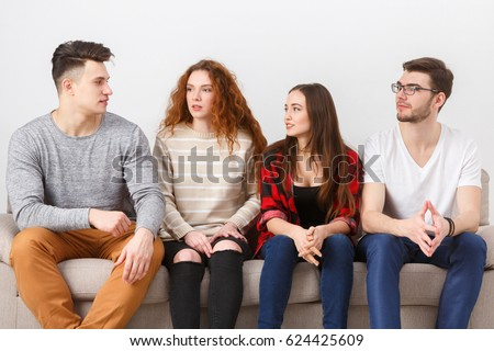 Friendship, education, students. Young people wait for exam, sitting at home interior and chatting