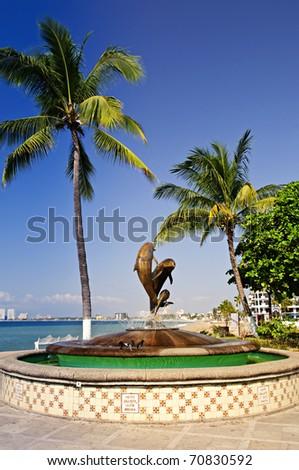 Friendship fountain on Malecon at Pacific ocean in Puerto Vallarta, Mexico - stock photo