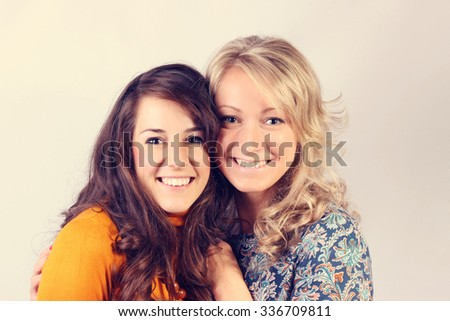 Friendship, happiness concept - Beautiful young women looking at the camera - stock photo