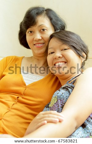 Friendship of asian ethnic mother with teenage daughter - stock photo