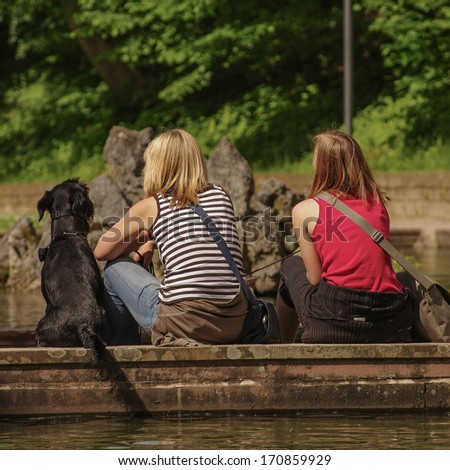 Friendship of humans and animals, they are like us - stock photo