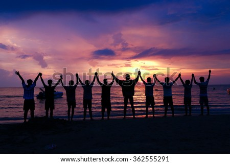 friendship, summer vacation, holidays, party and people concept - group of smiling friends  on the beach - stock photo