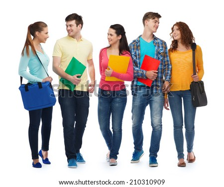 friendship, youth, education and people - group of smiling teenagers with folders and bags - stock photo