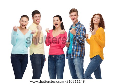 friendship, youth, gesture and people concept - group of smiling teenagers showing triumph gesture