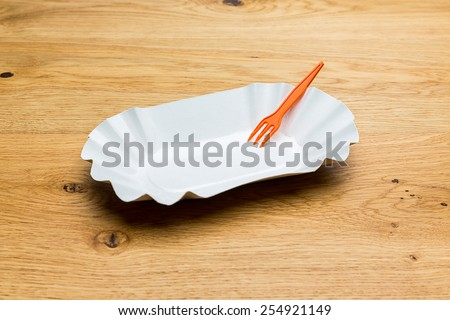 fries shell with plastic fork on wooden background - stock photo