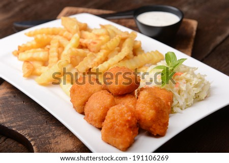 Fries with chicken nuggets and salad - stock photo