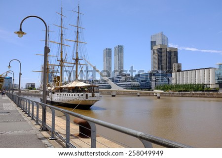 Frigate and Women's bridge in Puerto Madero, Buenos Aires - stock photo