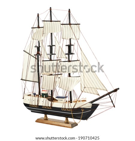 Frigate ship toy model isolated over the white background - stock photo