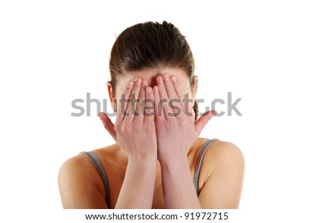 Frighten girl hides her face in hands, isolated on a white background - stock photo