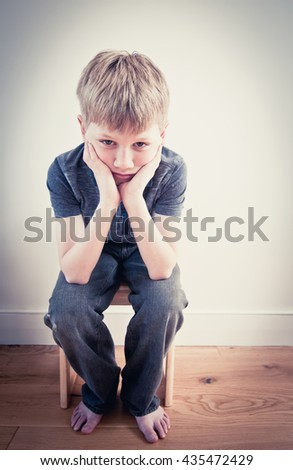 Frightened and lonely child - stock photo