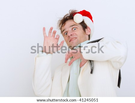 Frightened by approach of new year the person on a white background - stock photo