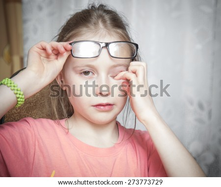 Frightened child closed his hands over eyes and crying. - stock photo