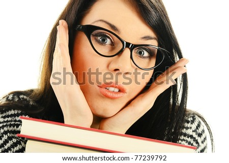 Frightened female with books before exams - stock photo