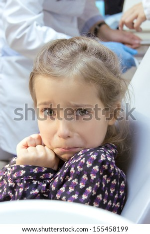frightened girl at dentist's office - stock photo