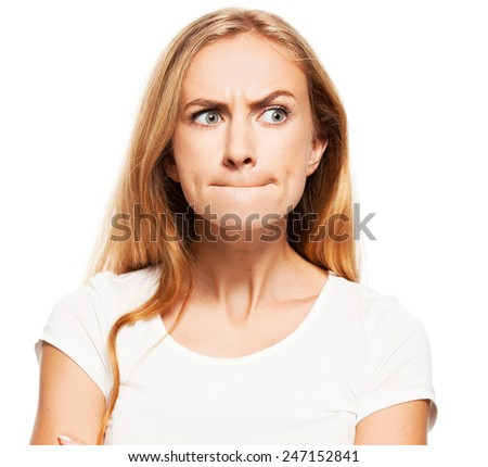 Frightened girl. Female with pinched lips - stock photo