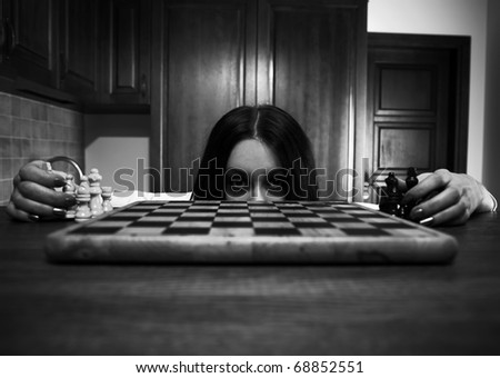 frightened girl looking out of chess board